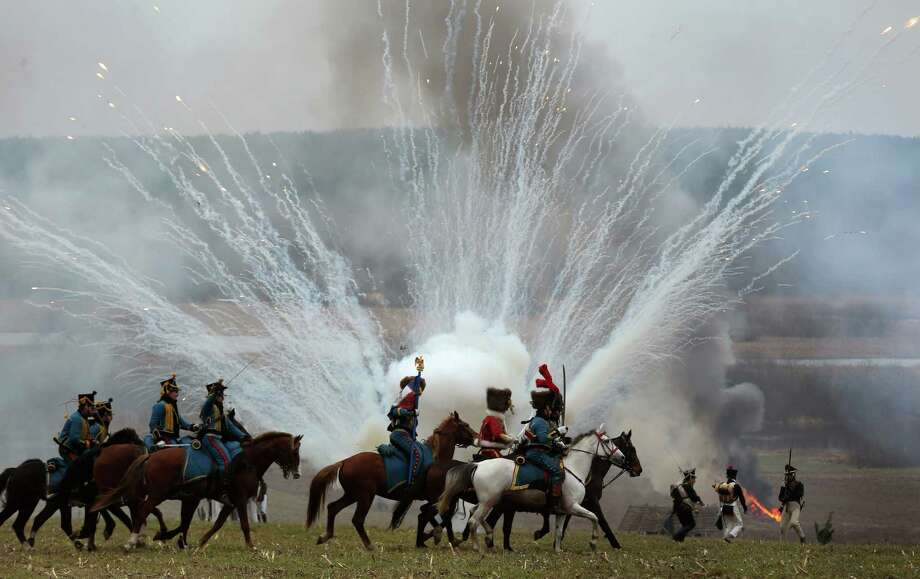 Men dressed as 1812-era Russian and French soldiers re-enact a staged battle near the Belarus village of Bryli, about 115 kilometers (70 miles) east of the capital, Minsk, Saturday, Nov. 24, 2012, to mark the 200th anniversary of the Berezina battle during Napoleon's army retreat from Russia. Photo: Sergei Grits, Associated Press / AP