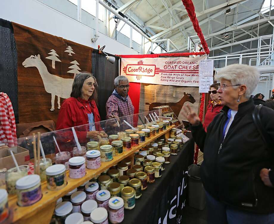 Nancy Coonridge (left) offers customers samples of her organic goat cheese from New Mexico at The Fort Mason Center in San Francisco, Calif. for the 34th annual Craftswomen Holiday fair. The works of female artists and craftwomen are being sold in a benefit for the city's Women's Building and its programs. Photo: Rashad Sisemore, The Chronicle