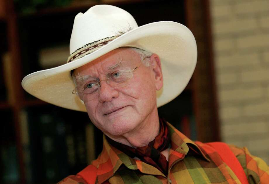 "In this Thursday, Oct. 9, 2008 photo, actor Larry Hagman listens to a reporter's question while visiting the Southfork Ranch in Parker, Texas, made famous in the television show ""Dallas."" Actor Larry Hagman, who for more than a decade played villainous patriarch JR Ewing in the TV soap Dallas, has died at the age of 81, his family said Saturday Nov. 24, 2012(AP Photo/Tony Gutierrez) Photo: Tony Gutierrez"
