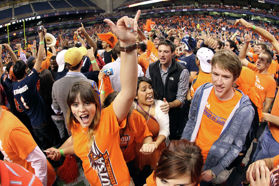 UTSA 38 - Texas State 31: UTSA fans celebrate on the field after the game against Texas State at the Alamodome on Saturday, Nov. 24, 2012. The Roadrunners defeated the Bobcats 38-31. Photo: Kin Man Hui, San Antonio Express-News / © 2012 San Antonio Express-News