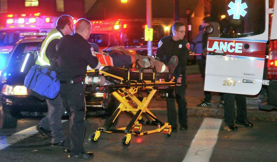 An injured firefighter is wheeled from the scene after a building was leveled by an explosion in downtown Springfield, Mass. on Friday, Nov. 23, 2012. (AP Photo/Springfield Republican, Don Treeger) Photo: Don Treeger