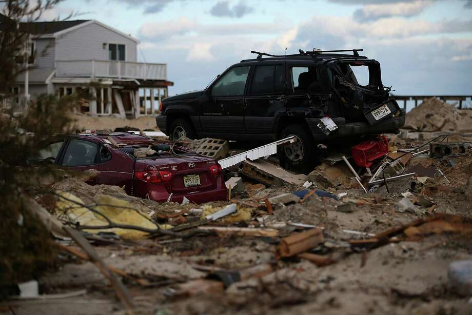 ORTLEY BEACH, NJ - NOVEMBER 24: Two cars sit on empty lots where houses once stood, detroyed by Superstorm Sandy, on November 24, 2012 in Ortley Beach, New Jersey. New Jersey Gov. Christie estimated that Superstorm Sandy will cost New Jersey $29.4 billion in damage and economic losses.  (Photo by Mark Wilson/Getty Images) Photo: Mark Wilson