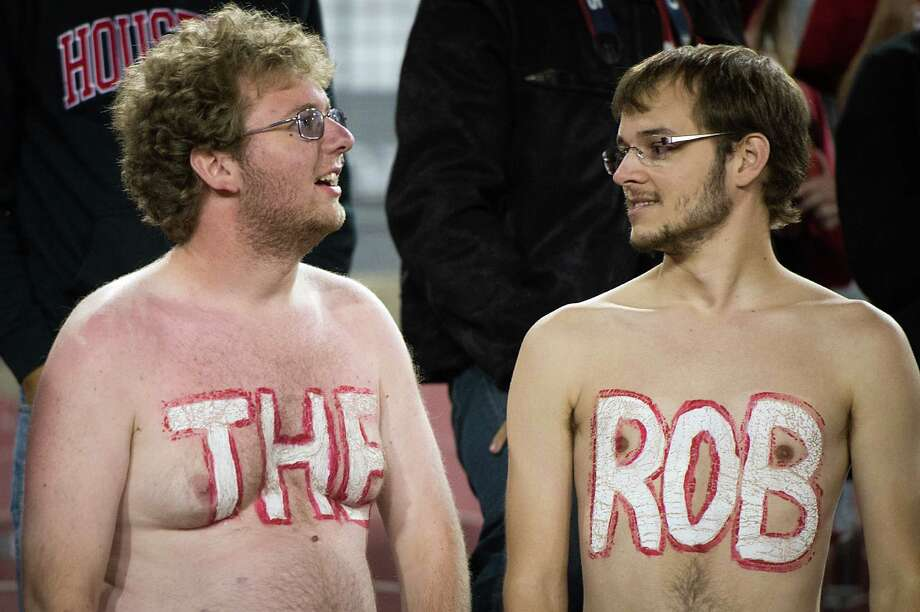 Houston fans wear their affection for Robertson stadium on their chests during the second half of a college football game against Tulane at Robertson Stadium, Saturday, Nov. 24, 2012, in Houston. The stadium, which officially opened in 1942, will be demolished and replaced with a state-of-the-art facility in time for the 2014 football season. Houston won the game 40-17. Photo: Smiley N. Pool, Houston Chronicle / © 2012  Houston Chronicle