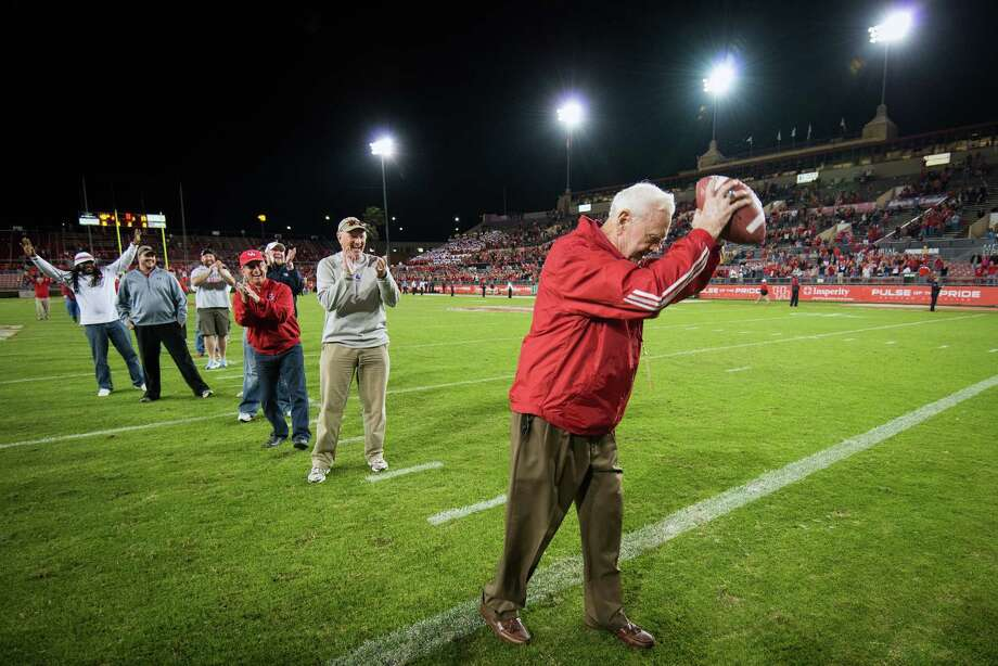 Former Houston coach Bill Yeoman spikes a football to ceremonially score the final touchdown in the in Robertson Stadium following a college football game against Tulane on Saturday, Nov. 24, 2012, in Houston. Photo: Smiley N. Pool, Houston Chronicle / © 2012  Houston Chronicle