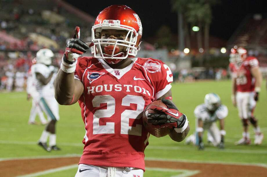Houston running back Ryan Jackson (22) points to the crowd after scoring on a touchdown run against Tulane during the second half of a college football game at Robertson Stadium, Saturday, Nov. 24, 2012, in Houston. Houston won the game 40-17. Photo: Smiley N. Pool, Houston Chronicle / © 2012  Houston Chronicle
