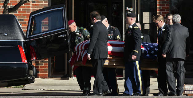 The flag-draped casket of retired Army Sgt. Joshua Michael is moved to a hearse after the funeral service at Cornerstone Church Saturday Nov. 24, 2012 in Amarillo, Tx. Michael was one of four veterans killed when a train struck a parade float that he, his wife Daylyn Michael (not pictured) and others were riding on Thursday Nov. 15, 2012 in Midland, Tx. Photo: Edward A. Ornelas, San Antonio Express-News / © 2012 San Antonio Express-News