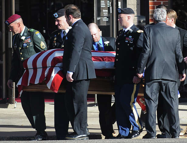 The casket of Army Sgt. Joshua C. Michael is loaded onto a hearse after a his funeral service Saturday, Nov. 24, 2012 in Amarillo, Texas. Michael died when a Veterans Day parade float he was riding on was struck by a train Nov. 15 in Midland, Texas. Photo: Roberto Rodriguez, AP Photo/The Amarillo Globe News / Amarillo Globe-News