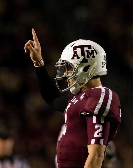 Texas A&M quarterback Johnny Manziel (2) gets the play from the sidelines during the second quarter