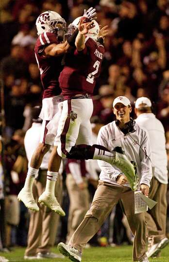 Texas A&M defensive back Dustin Harris (22) and Texas A&M quarterback Johnny Manziel (2) celebrate a