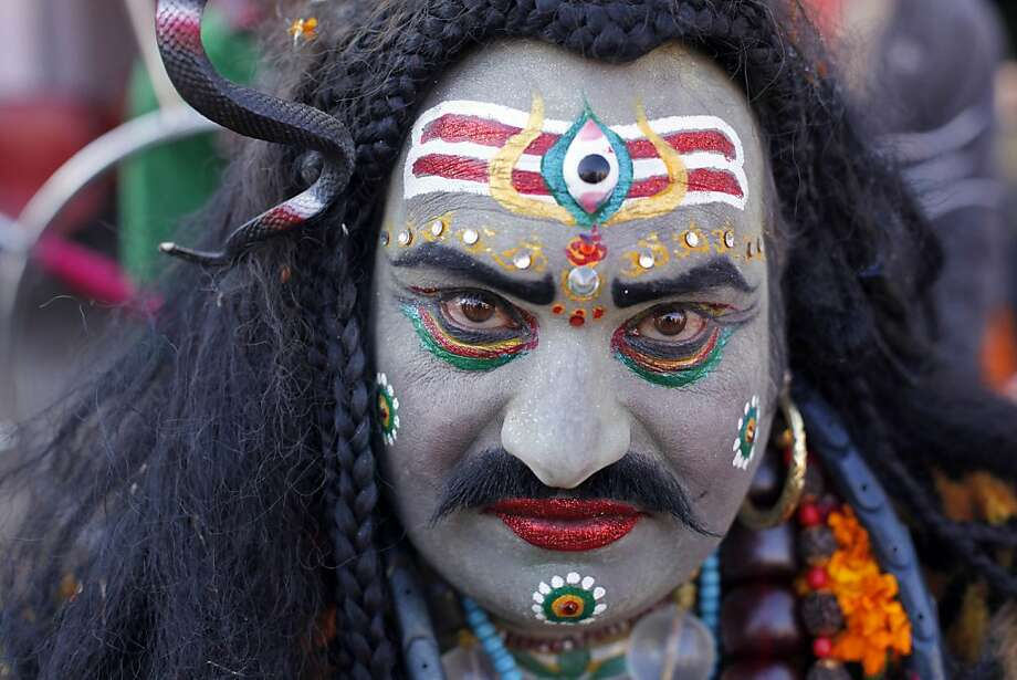 An Indian man, dressed as Hindu God Lord Shiva, participates in a procession during the annual cattle fair in Pushkar, Rajasthan, India, Saturday, Nov. 24, 2012.  Pushkar, located on the banks of Pushkar Lake, is a popular Hindu pilgrimage spot that is also frequented by foreign tourists who come to the town for the annual cattle fair and camel races. (AP Photo/Rajesh Kumar Singh) Photo: Rajesh Kumar Singh, Associated Press
