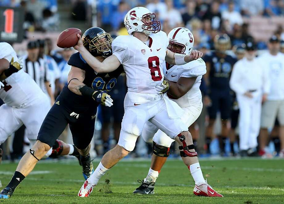 Quarterback Kevin Hogan doesn't let the success he has with his right arm and his legs go to his head, his teammates say. Photo: Stephen Dunn, Getty Images