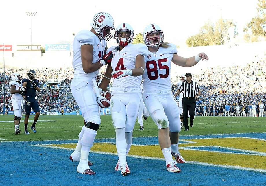 PASADENA, CA - NOVEMBER 24:  Drew Terrell #4, Ryan Hewitt #85, and Levine Toilolo #11 of the Stanford Cardinal celebrate Terrell's 11 yard touchdown catch in the first quarter against the UCLA Bruins at the Rose Bowl on October 13, 2012 in Pasadena, California.  (Photo by Stephen Dunn/Getty Images) Photo: Stephen Dunn, Getty Images