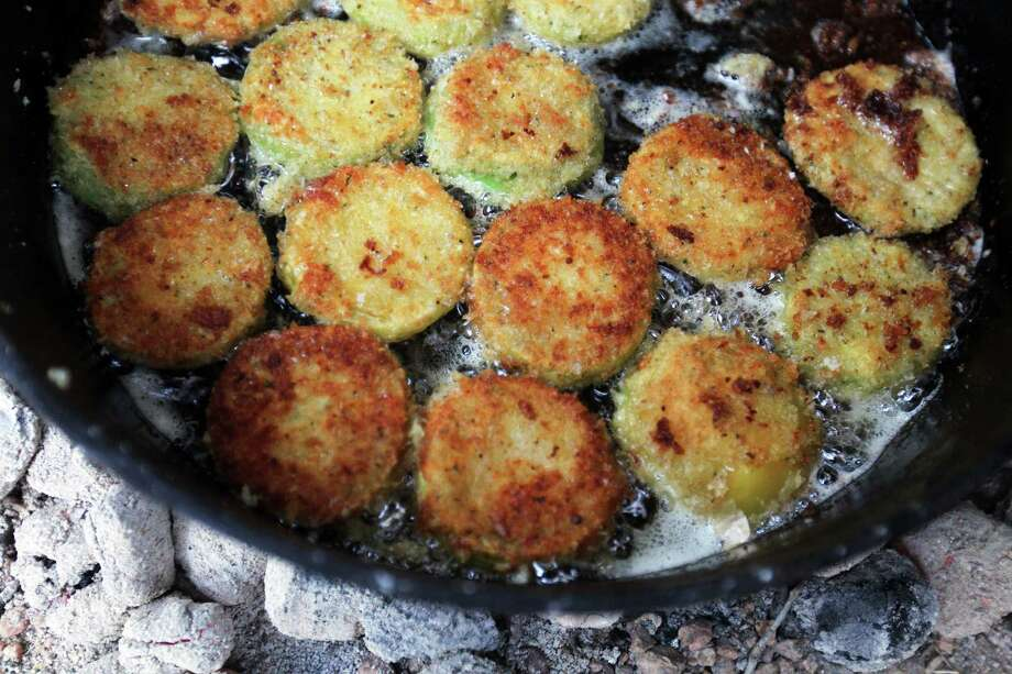 Fried green tomatoes brown for Bill Perry's Green Egg I Am I Am Ragu during the Fifth Annual Wang Dang Doodle Dutch Oven Cook-Off at the home of Cheryl and John Schilhab near Boerne, Saturday, Nov. 17, 2012. Perry won the people's choice award in the competition. Photo: Jennifer Whitney, For The Express-News / © Jennifer Whitney