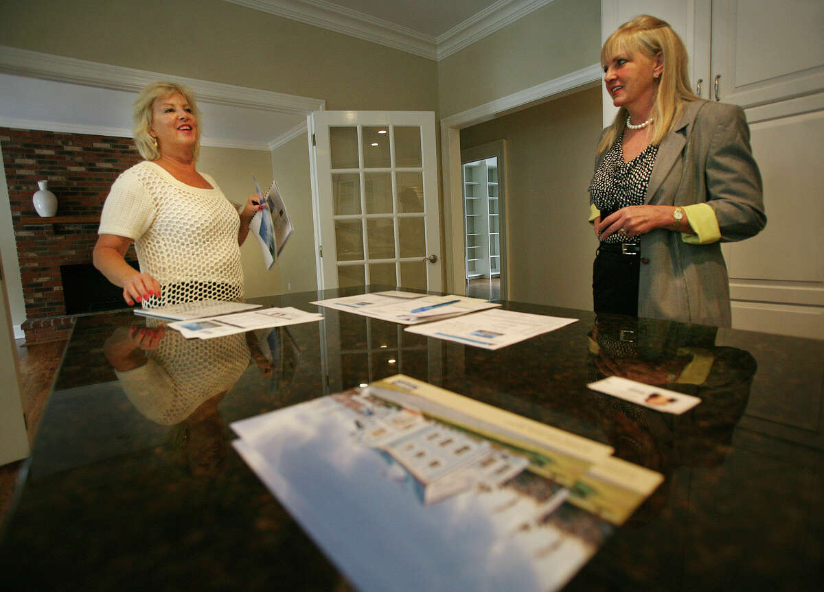 Gail Newell, left, of New York City, shops for a new home with realtor Vickie Kelley, of Camelot Real Estate, in Weston on Thursday, October 4, 2012. Newell, who has a daughter, would like to move to Weston for the town's top quality school system.