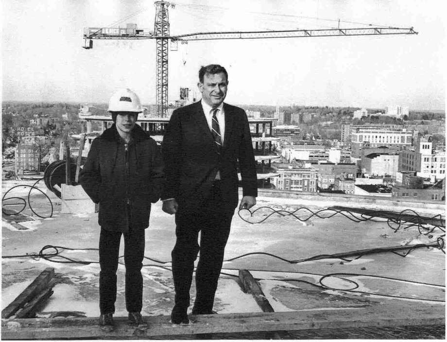 Robert Rich and his son, Thomas Rich, atop St. John's Towers in 1969, when Robert was 40 and Thomas was 10. It was the first housing F.D. Rich Company built in downtown Stamford. Robert Rich died Saturday, Nov. 17, 2012 at age 84. Photo: The (Stamford) Advocate