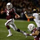 Texas A&M Aggies quarterback Johnny Manziel #2 rushes for a gain during their game against the Missouri Tigers at Kyle Field on November 24, 2012 in College Station, Texas.  (Scott Halleran / Getty Images)
