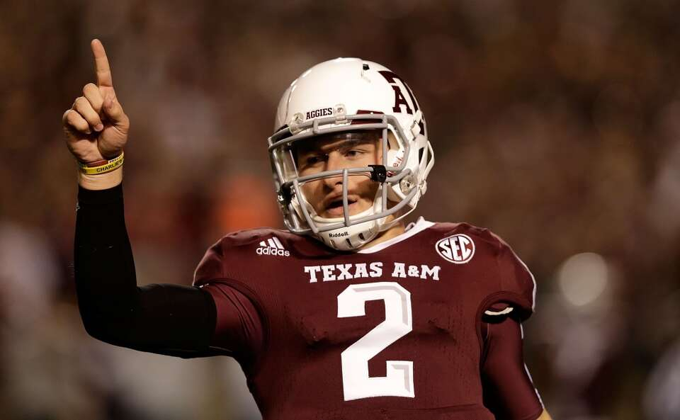 Texas A&M Aggies quarterback Johnny Manziel #2 celebrates a first quarter touchdown during their gam