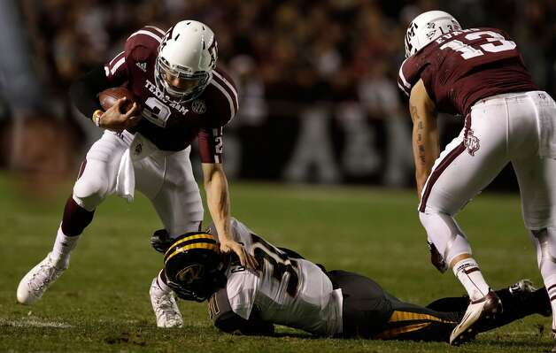 Johnny Manziel #2 of the Texas A&M Aggies is taken down by E.J. Gaines #31 of the Missouri Tigers at Kyle Field on November 24, 2012 in College Station, Texas.  (Scott Halleran / Getty Images)
