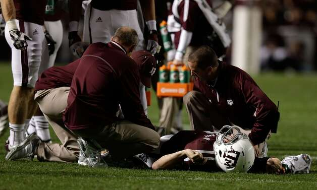 Johnny Manziel #2 of the Texas A&M Aggies is checked by trainers on the field during their game against the Missouri Tigers at Kyle Field on November 24, 2012 in College Station, Texas.  (Scott Halleran / Getty Images)