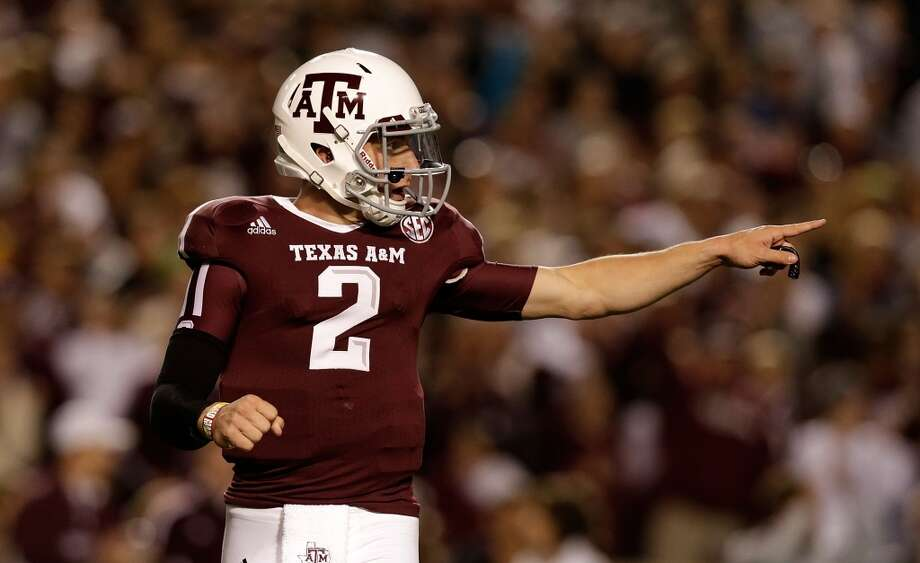 Johnny Manziel #2 of the Texas A&M Aggies celebrates a first quarter touch down during their game against the Missouri Tigers at Kyle Field on November 24, 2012 in College Station, Texas.  (Scott Halleran / Getty Images)