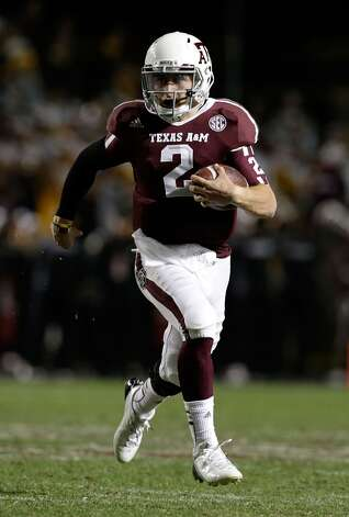 Johnny Manziel #2 of the Texas A&M Aggies runs upfield during their game against the Missouri Tigers at Kyle Field on November 24, 2012 in College Station, Texas.  (Scott Halleran / Getty Images)