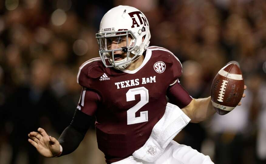 Johnny Manziel #2 of the Texas A&M Aggies runs upfield during their game against the Missouri Tigers