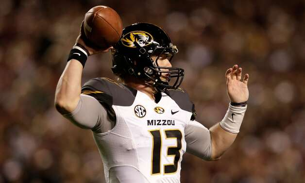 Corbin Berkstresser #13 of the Missouri Tigers throws a pass against the Texas A&M Aggies at Kyle Field on November 24, 2012 in College Station, Texas.   (Scott Halleran / Getty Images)