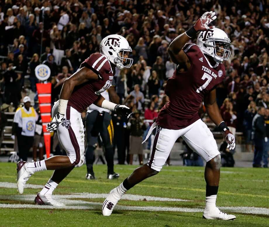 Uzoma Nwachukwa #7 celebrates his second quarter touchdown alongside teammate Malcome Kennedy #84 of Texas A&M Aggies during their game against the Missouri Tigers at Kyle Field on November 24, 2012 in College Station, Texas.  (Scott Halleran / Getty Images)
