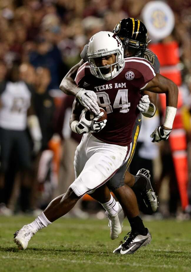 Malcome Kennedy #84 of Texas A&M Aggies is tackled by Ian Simon #21 of the Missouri Tigers at Kyle Field on November 24, 2012 in College Station, Texas.  (Scott Halleran / Getty Images)