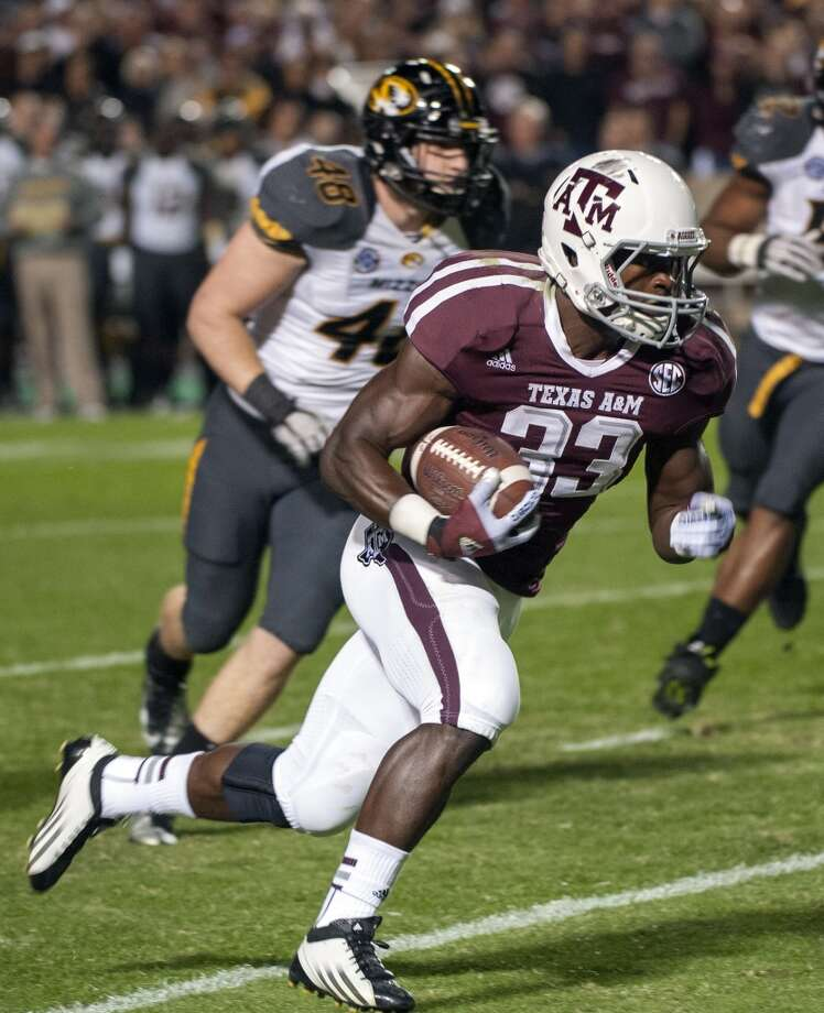 Texas A&M's Christine Michael (33) runs around Missouri's Andrew Wilson (48) for a touchdown during the first quarter of an NCAA college football game on Saturday, Nov. 24, 2012, in College Station, Texas.  (Dave Einsel / Associated Press)