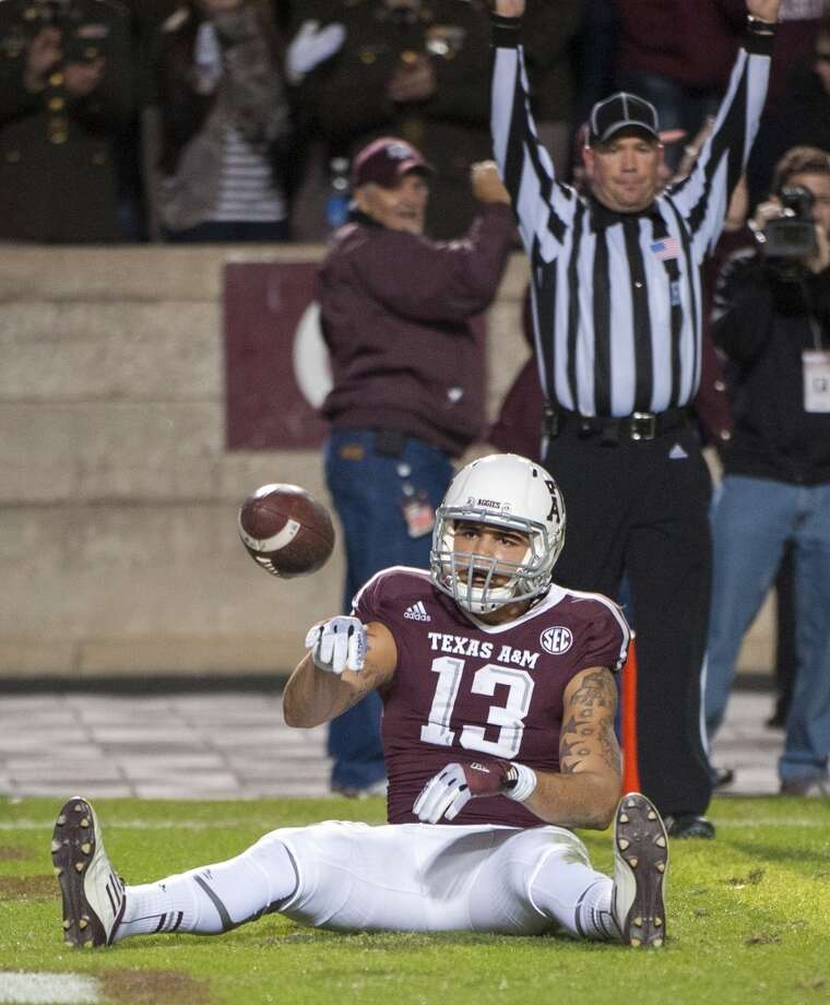 Texas A&M's Mike Evans reacts after making a touchdown catch against Missouri during the second quarter of an NCAA college football game on Saturday, Nov. 24, 2012, in College Station, Texas.  (Dave Einsel / Associated Press)
