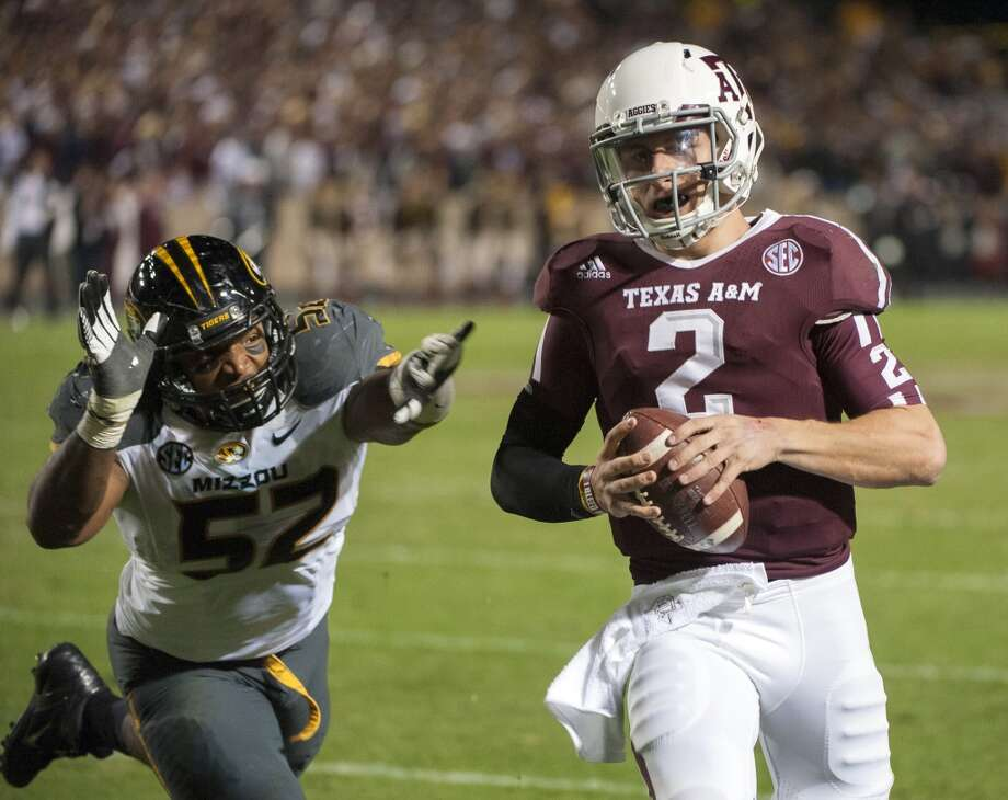 Texas A&M quarterback Johnny Manziel (2) runs from Missouri's Michael Sam (52) during the second quarter of an NCAA college football game on Saturday, Nov. 24, 2012, in College Station, Texas. (Dave Einsel / Associated Press)