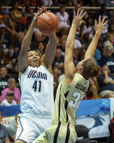 Connecticut center Kiah Stokes, left, pulls down a rebound against Purdue forward Sam Ostarello during an NCAA women's college basketball game in St. Thomas, U.S. Virgin Islands, Saturday, Nov. 24, 2012. Connecticut won 91-57. (AP Photo/Thomas Layer) Photo: Thomas Layer, Associated Press / AP