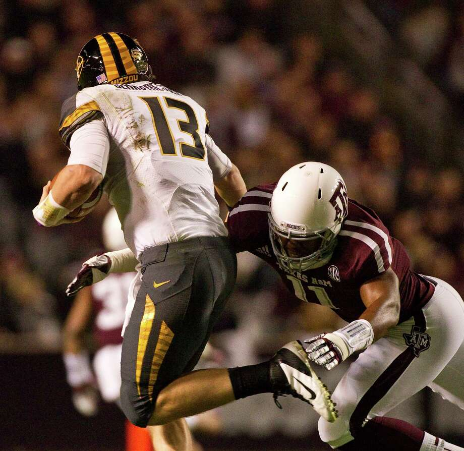 Missouri quarterback Corbin Berkstresser (13) is sacked by Texas A&M linebacker Jonathan Stewart (11) during the first quarter of a NCAA football game, Saturday, Nov. 24, 2012, in Kyle Field in College Station. Photo: Nick De La Torre, Houston Chronicle / © 2012  Houston Chronicle