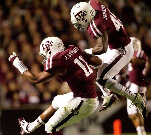 Texas A&M linebacker Jonathan Stewart (11) celebrates his quarterback sack with Texas A&M linebacker Steven Jenkins (45) during the first quarter of a NCAA football game against Missouri, Saturday, Nov. 24, 2012, in Kyle Field in College Station. Photo: Nick De La Torre, Houston Chronicle / © 2012  Houston Chronicle
