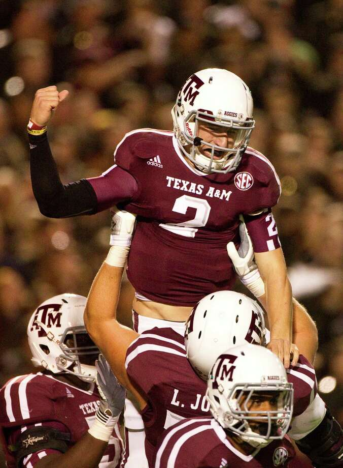 A&M 59, Missouri 29Texas A&M quarterback Johnny Manziel (2) is lifted by the offenseive line after running for a touchdown during the third quarter of a NCAA football game, Saturday, Nov. 24, 2012, in Kyle Field in College Station. Photo: Nick De La Torre, Houston Chronicle / © 2012  Houston Chronicle