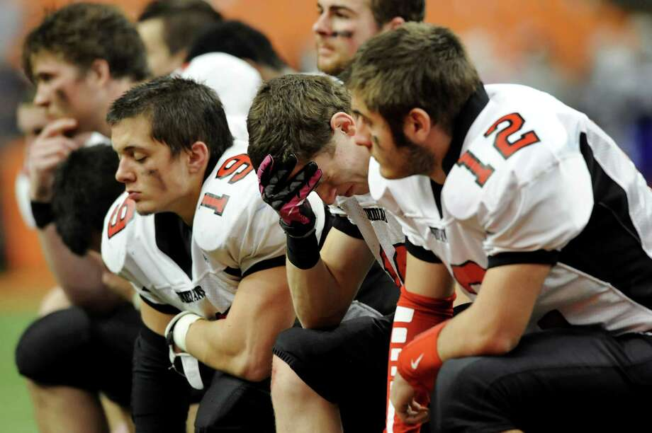 Glens Falls' Nate Plocharczyk (10), second from right, and his teammates react to their 42-12 loss to Maine-Endwell in the Class B football state final on Saturday, Nov. 24, 2012, at the Carrier Dome in Syracuse, N.Y. (Cindy Schultz / Times Union) Photo: Cindy Schultz / 00020205A
