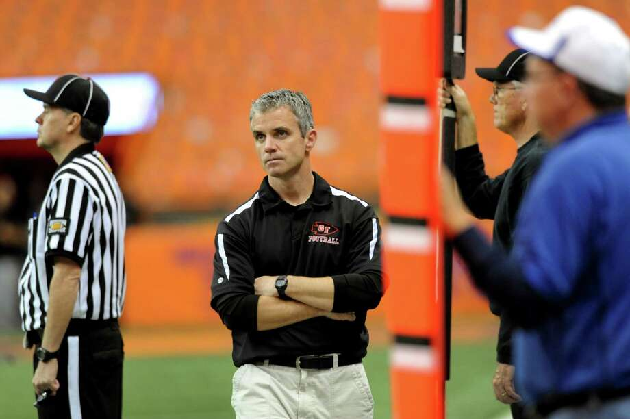Glens Falls' coach Pat Lilac, center, watches a replay on the jumbotron during the final minutes of their Class B football state final against  Maine-Endwell on Saturday, Nov. 24, 2012, at the Carrier Dome in Syracuse, N.Y. Maine-Endwell wins 42-12. (Cindy Schultz / Times Union) Photo: Cindy Schultz / 00020205A