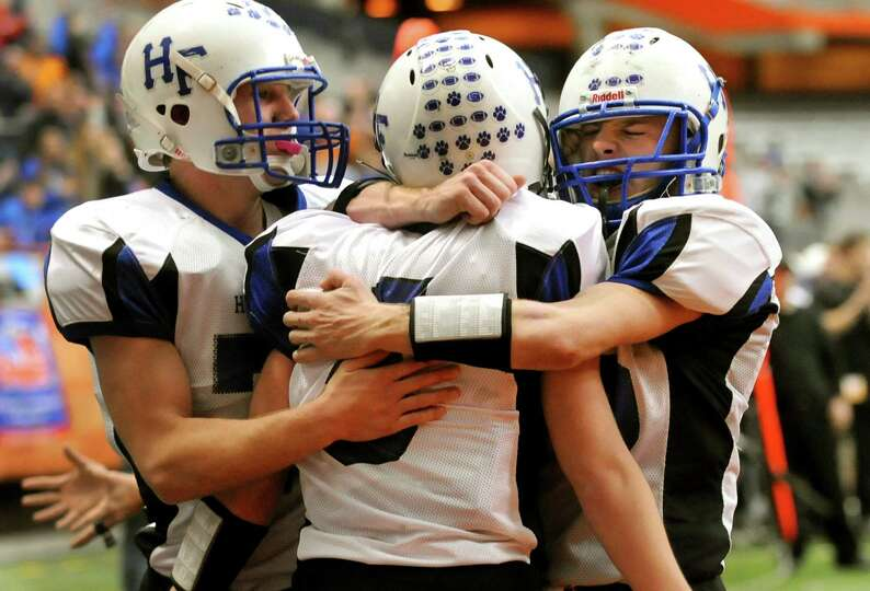 Hoosick Falls' Josh Brogue (5), center, celebrates his touchdown with teammates Derek Bird (77), lef