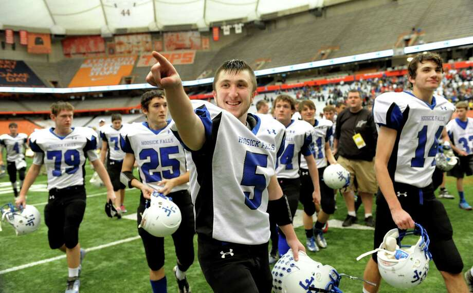 Hoosick Falls' Josh Brogue (5) salutes the fans when they win 34-21 over Hornell in the Class C football state final on Saturday, Nov. 24, 2012, at the Carrier Dome in Syracuse, N.Y. (Cindy Schultz / Times Union) Photo: Cindy Schultz / 00020204A