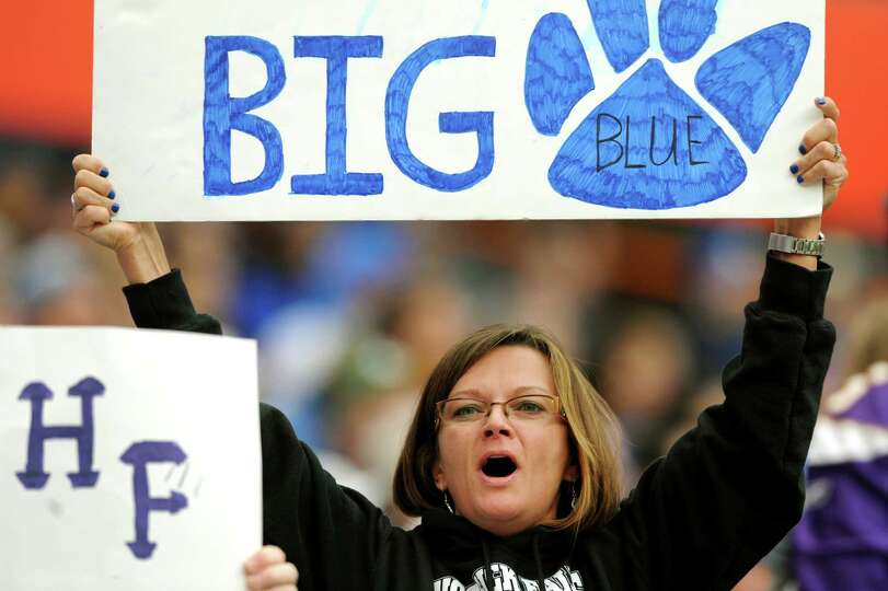 Hoosick Falls' football mom Florence DuBois shows her support during the Class C football state fina