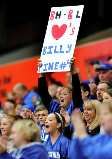 A Burnt Hills' fans shows support for Hoosick Falls' quarterback Billy Pine during their Class C foo