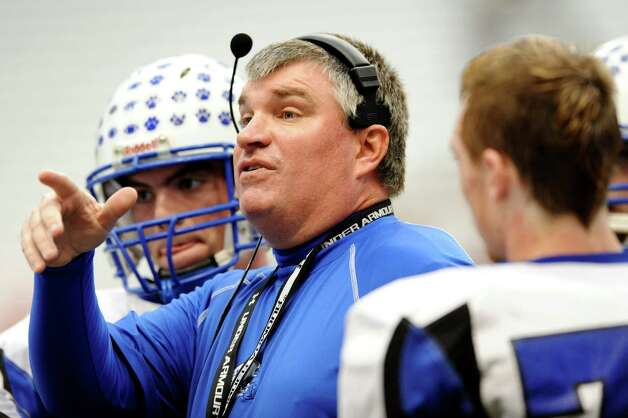 Hoosick Falls' coach Ron Jones advises his team in the final quarter of the Class C football state final against Hornell on Saturday, Nov. 24, 2012, at the Carrier Dome in Syracuse, N.Y. (Cindy Schultz / Times Union) Photo: Cindy Schultz / 00020204A