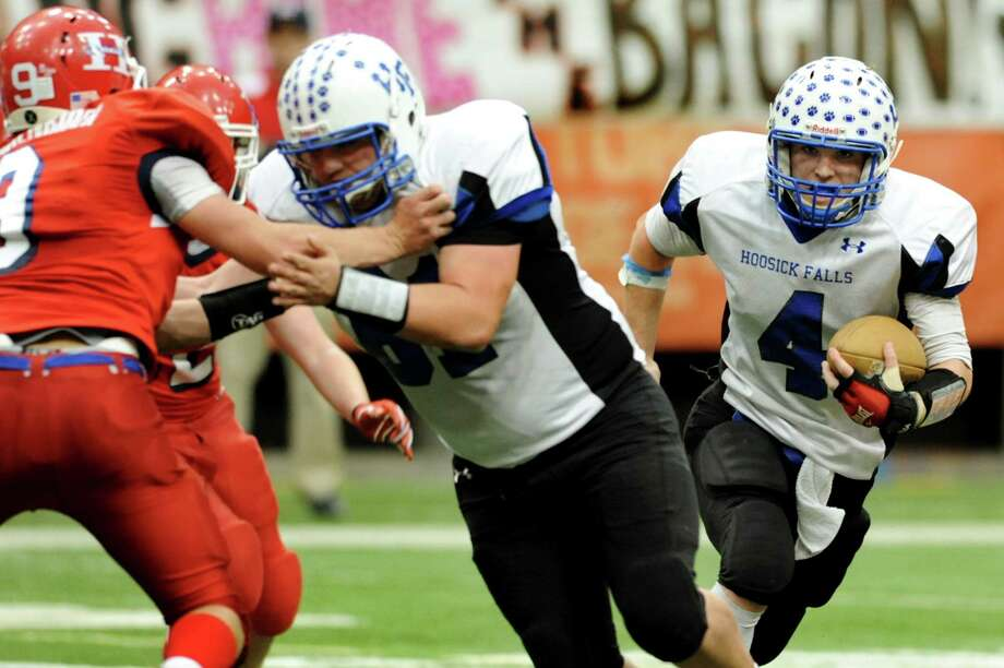 Hoosick Falls' quarterback Billy Pine (4), right, receives protection as he runs the ball during the Class C football state final against Hornell on Saturday, Nov. 24, 2012, at the Carrier Dome in Syracuse, N.Y. (Cindy Schultz / Times Union) Photo: Cindy Schultz / 00020204A