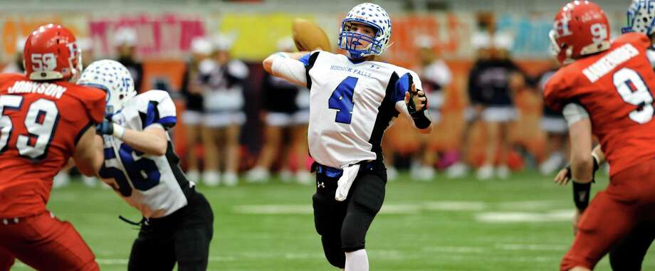 Hoosick Falls' quarterback Billy Pine (4), center, prepares to pass during the Class C football state final against Hornell on Saturday, Nov. 24, 2012, at the Carrier Dome in Syracuse, N.Y. (Cindy Schultz / Times Union) Photo: Cindy Schultz / 00020204A