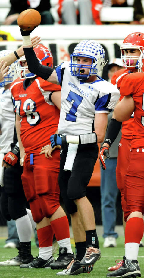 Hoosick Falls' Randy Tutunjian (7), center, holds the ball when his team recovers a fumble during the Class C football state final against Hornell on Saturday, Nov. 24, 2012, at the Carrier Dome in Syracuse, N.Y. (Cindy Schultz / Times Union) Photo: Cindy Schultz / 00020204A