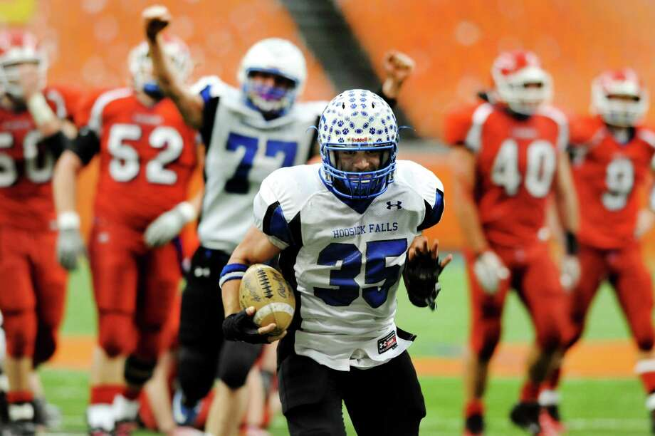 Hoosick Falls' Brad Burns (35), center, runs towards the endzone for a touch down as teammate Derek Bird (77) cheers during the Class C football state final against Hornell on Saturday, Nov. 24, 2012, at the Carrier Dome in Syracuse, N.Y. (Cindy Schultz / Times Union) Photo: Cindy Schultz / 00020204A