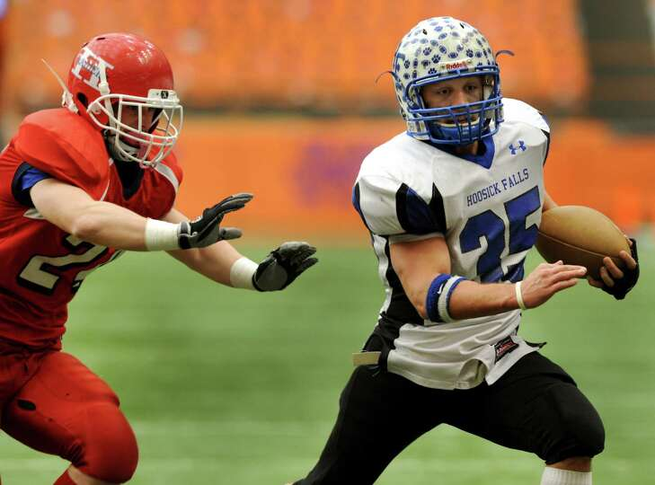 Hoosick Falls' Brad Burns (35), right, runs the ball as Hornell's James Cipriano (24) defends during