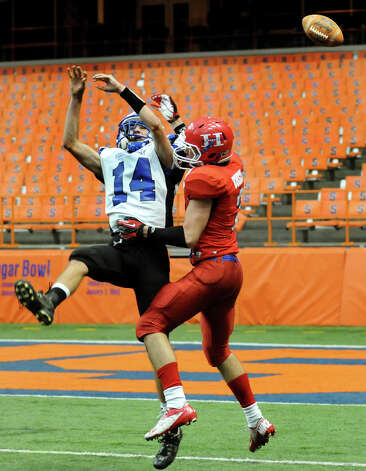 Hoosick Falls' Levi Brewster (14), left, attempts to catch a pas as Hornell's Brendan Buisch (2) defends during the Class C football state final on Saturday, Nov. 24, 2012, at the Carrier Dome in Syracuse, N.Y. (Cindy Schultz / Times Union) Photo: Cindy Schultz / 00020204A