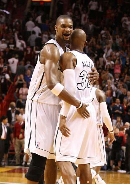 Chris Bosh (left) hugs Ray Allen after Allen's three- pointer put Miami ahead of Cleveland for good.